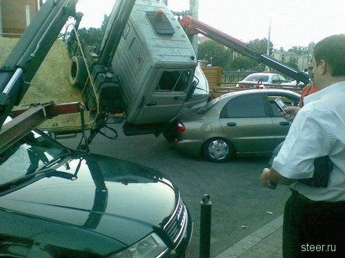 эвакуатор против Audi